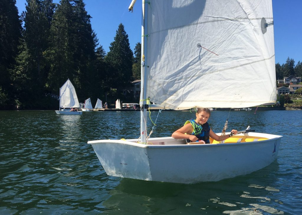 Sail camp sailor learns to drive her boat